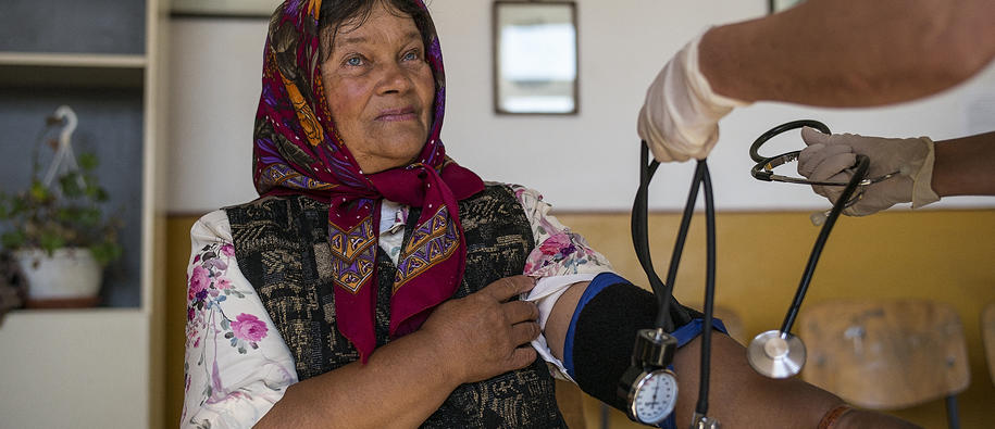 An elderly woman getting her blood pressure measured